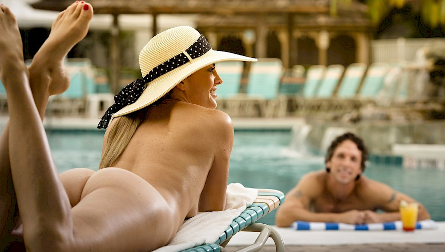 Couple lounging by pool