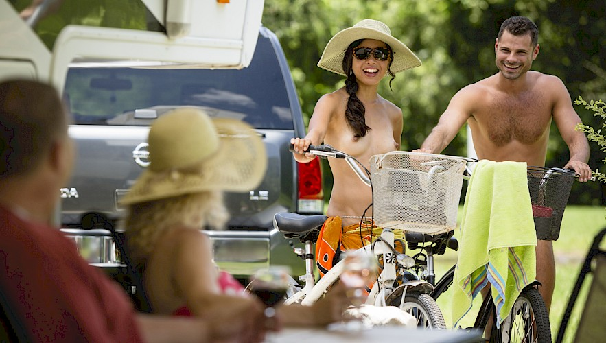 Couple on bikes in the campground